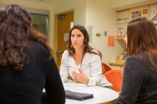 Susan Kinnebrew, who directs Child and Family Life Services at Packard  Children's, meets with members of her staff.