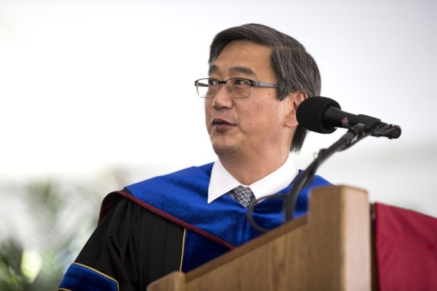 Peter Kim speaking to graduates