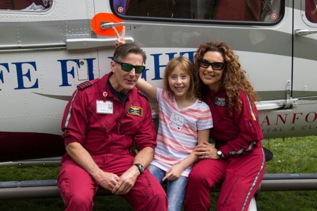 Life Flight helicopter crew with young girl