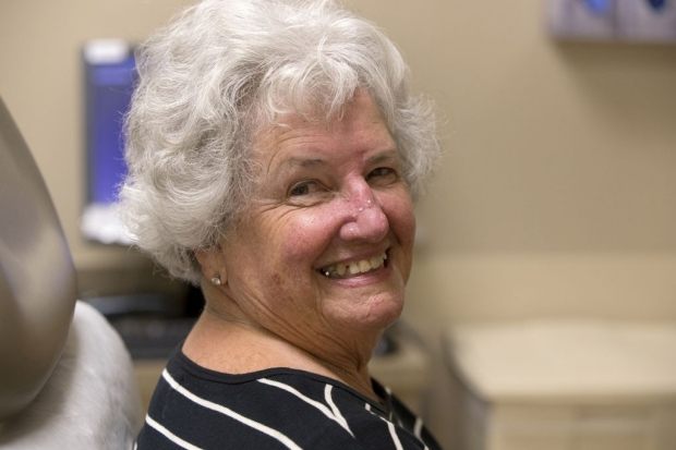 Woman smiling after Mohs surgery