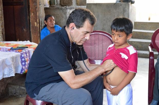 Physician examining a Guatemalan boy