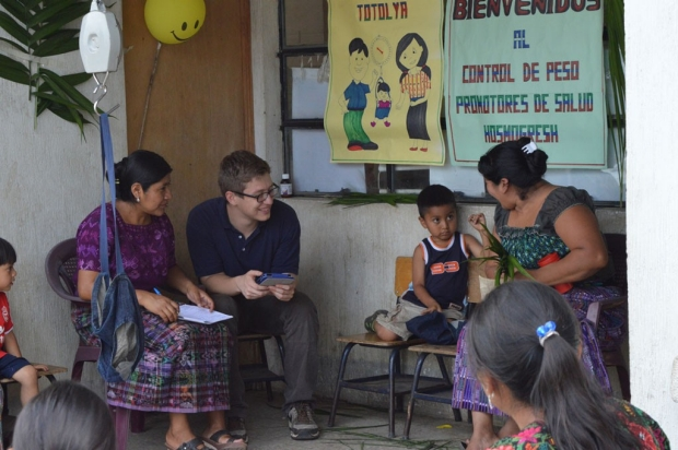 Research assistant working with local health promoters in Guatemala