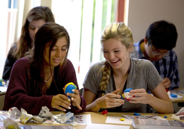 Two girls modeling brains out of clay