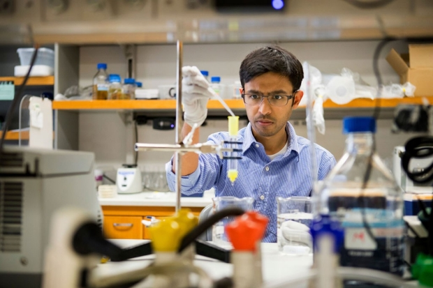 Aashish Manglik working in a chemistry lab
