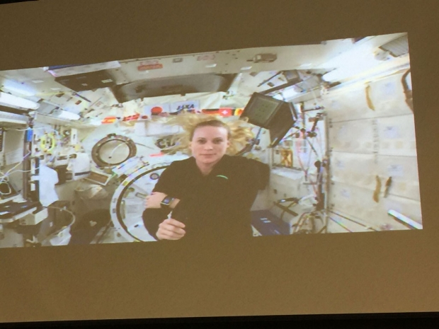 Woman astronaut speaking from the space station