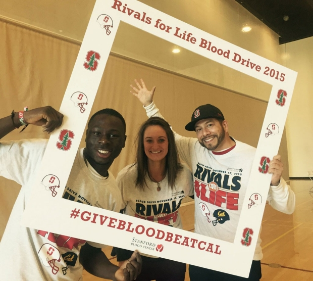 Three students wearing T-shirts supporting the Stanford-Cal blood drive