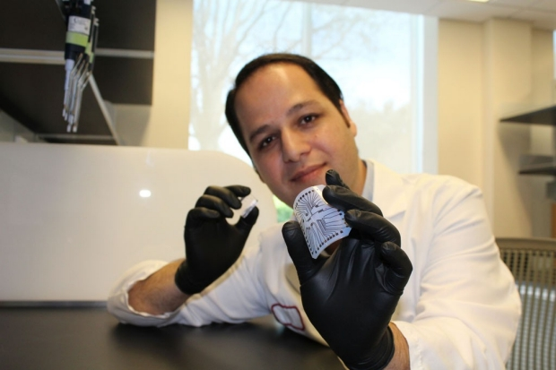 Scientist holding a biochip