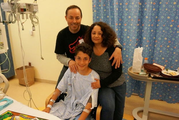 Teenage boy and his parents in a hospital room