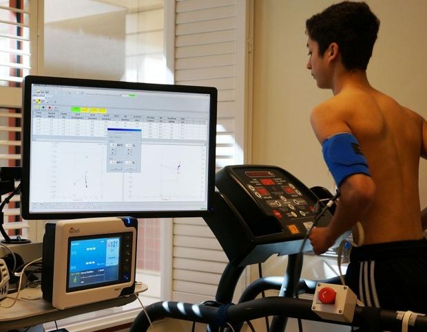 Teenage boy on a treadmill during a stress test