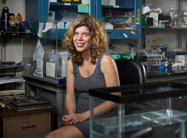 Scientist sitting in her lab