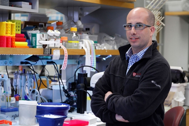 Scientist standing near a lab bench