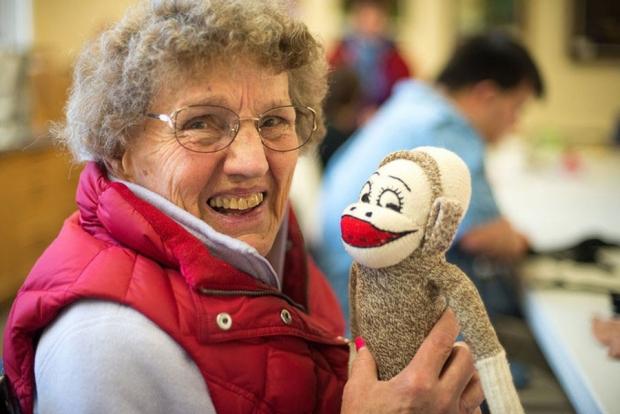 Woman holding a sock monkey
