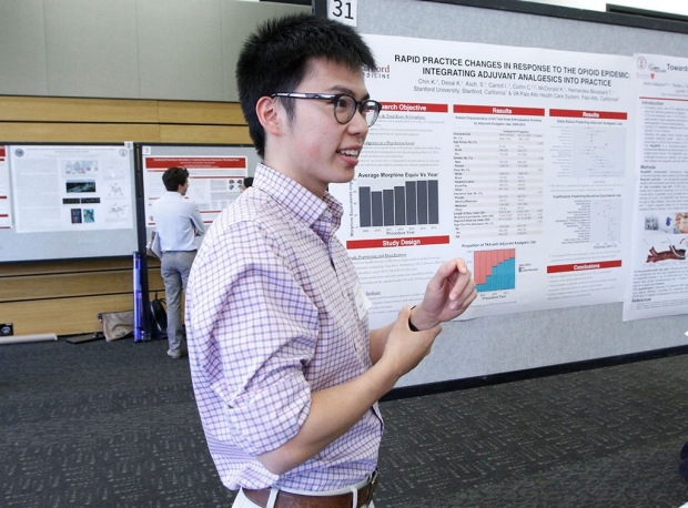 Man standing in front of a research poster