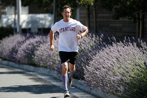 Man running outdoors in a Stanford T-shirt