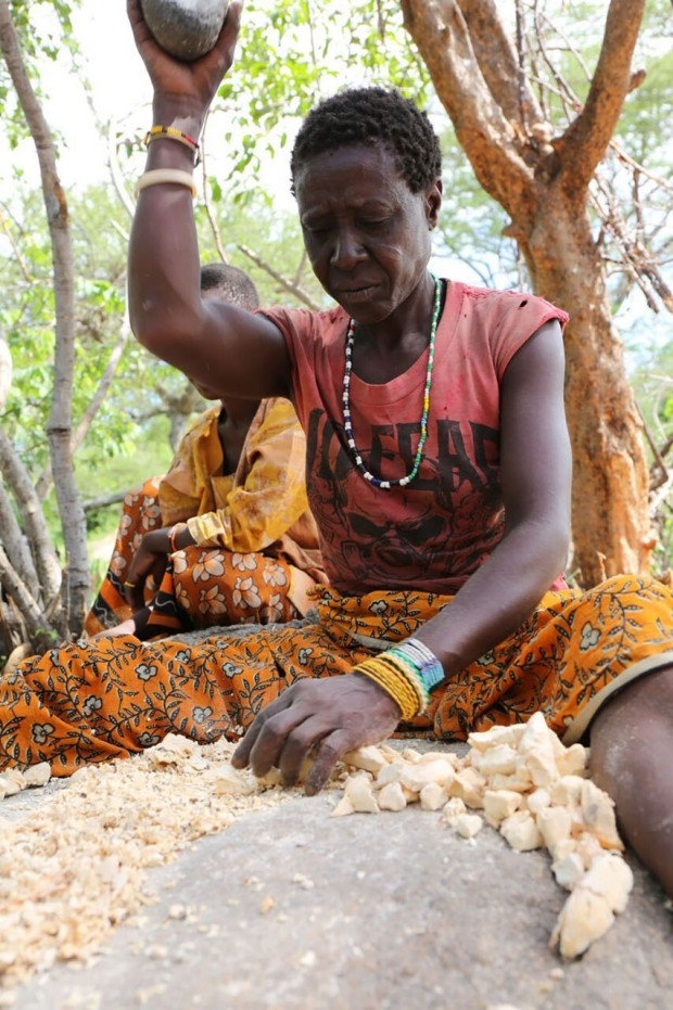 Hadza woman grinding grain