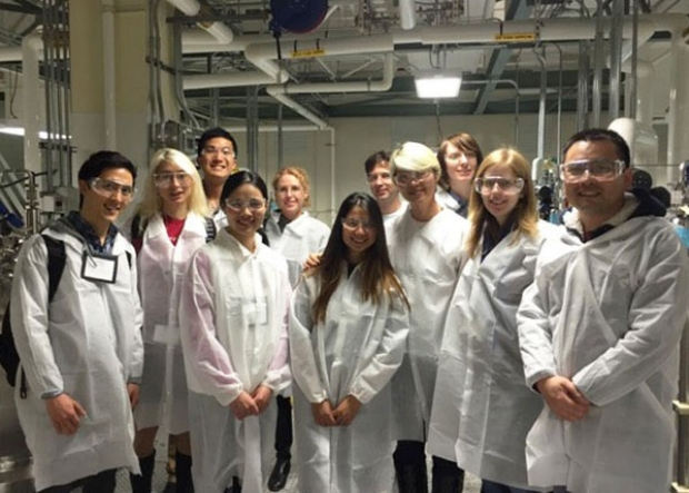 Students in lab coats standing in a lab