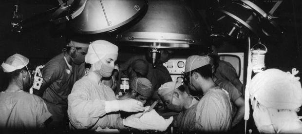 Black-and-white photo of the 1968 heart transplant surgery at Stanford