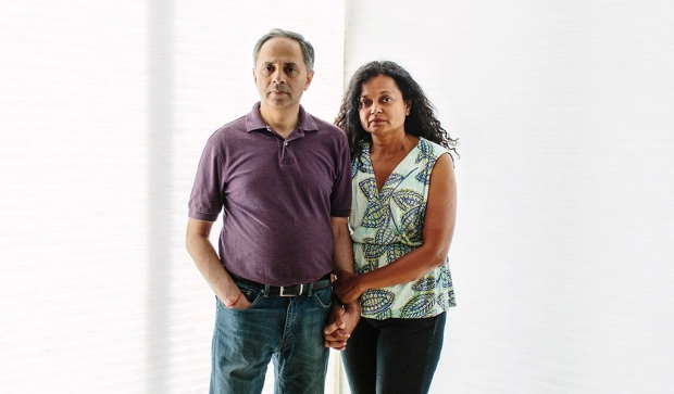 Man and woman standing in front of a white backdrop