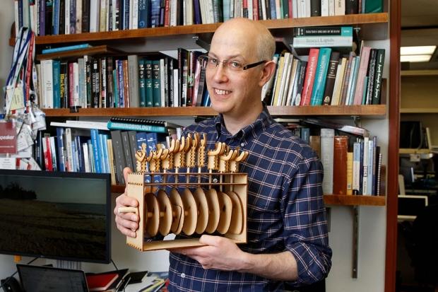 David Schneider holding a data sculpture he created