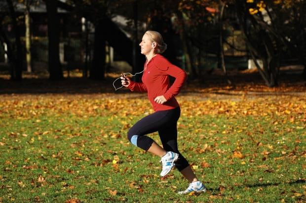 Woman running across grass
