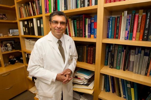 Robert Jackler standing near bookshelves in his office