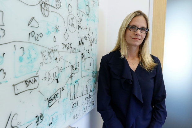 Christina Curtis standing in front of a whiteboard