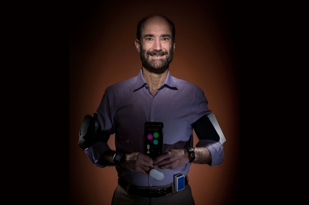Michael Snyder with several wearable technologies