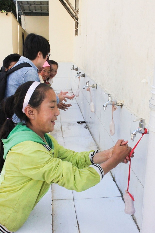 Chinese girl washing her hands