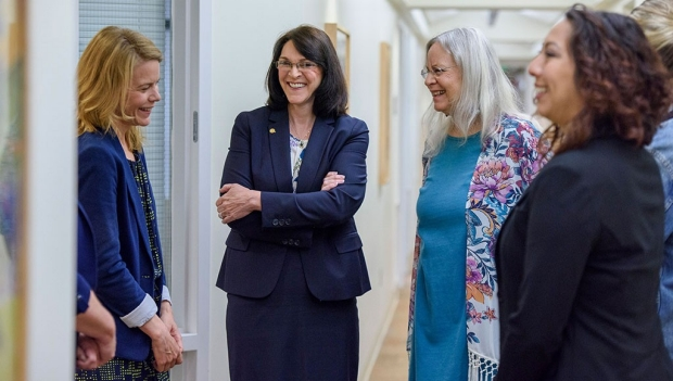 Sheila Dolezal, second from left, meets with her team