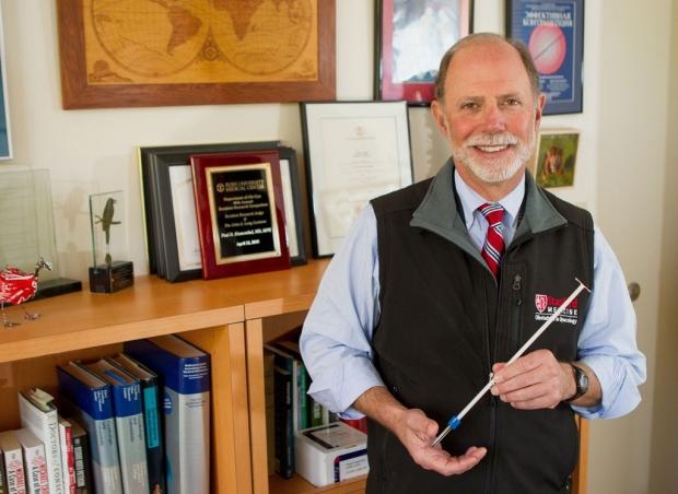 Paul Blumenthal holding an IUD inserter