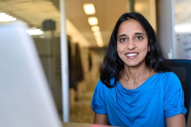 Manali Patel sitting at her desk