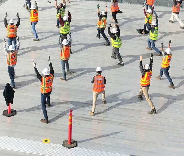 Construction workers in yoga poses