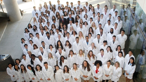 New PhD students welcomed with lab coats