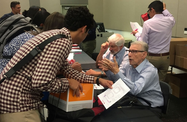 Daniel Bernstein and Paul Berg talking to students
