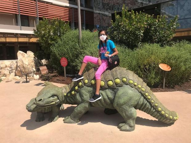 Lizneidy Serratos on a dinosaur