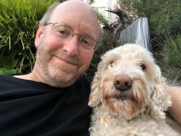 Dan Rosenbaum and his dog