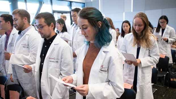 Donning lab coats, new graduate students embark on bioscience studies