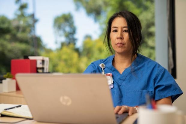 nurse with computer