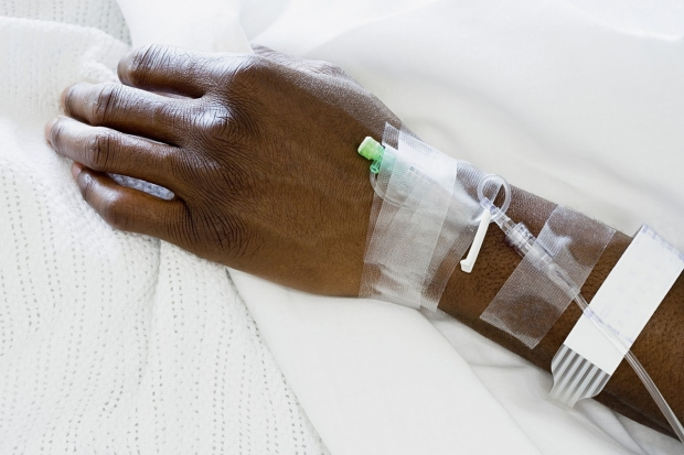 patient's hand attached to IV drip