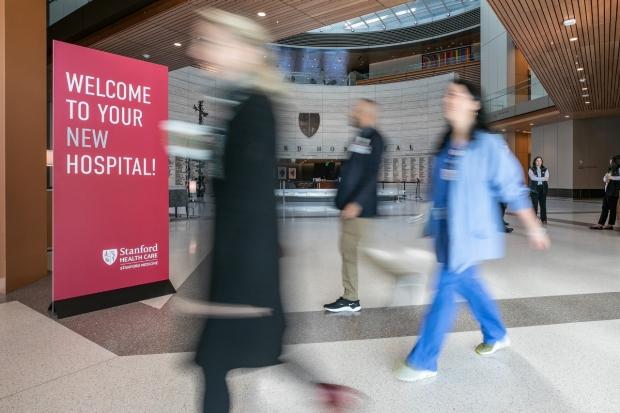 People walking in atrium of new hospital