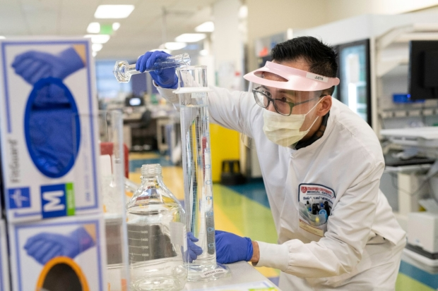 senior clinical laboratory scientist at Stanford Health Care prepares reagents