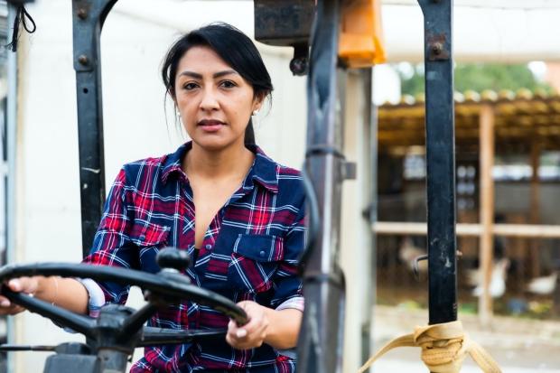 Latina driving tractor