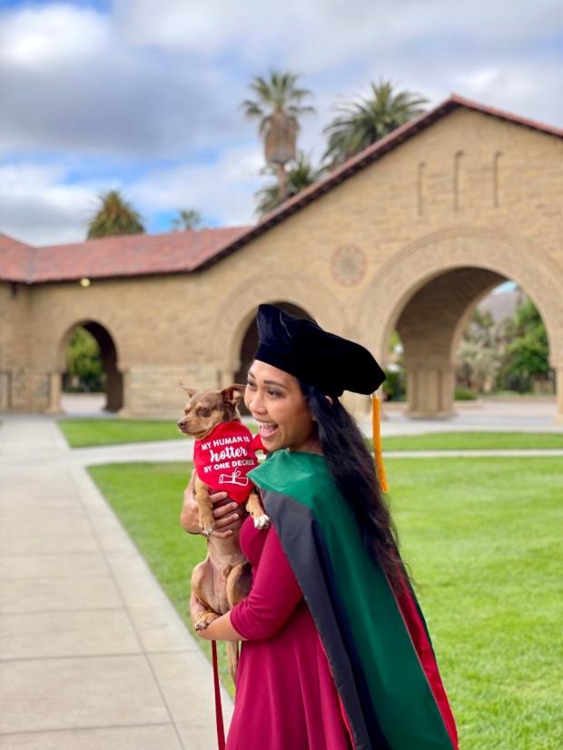 Natasha Abadilla holding her dog