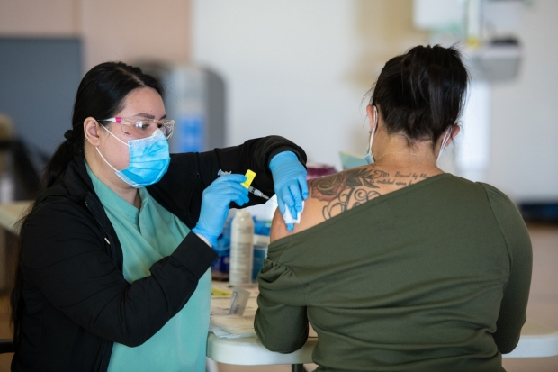 woman receiving vaccine shot