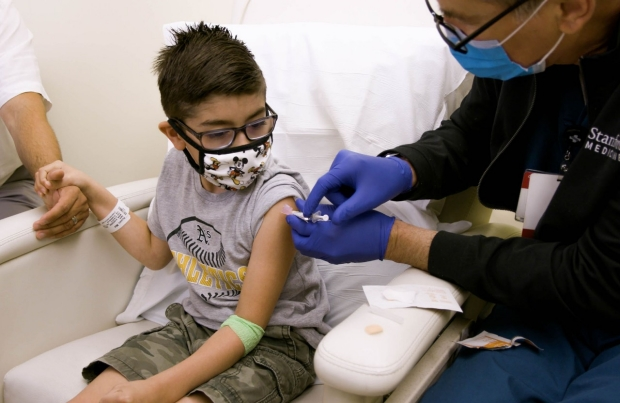 Child is being vaccinated at Stanford Health Care
