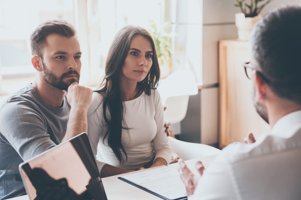 couple consulting with a financial counselor