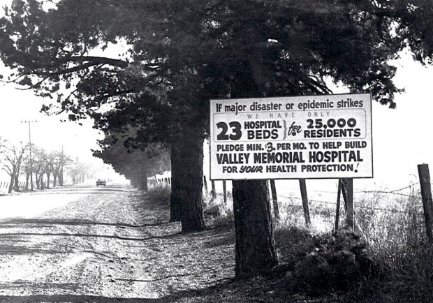 A sign encouraging donations for the creation of Valley Memorial Hospital sits on Stanley Boulevard in the 1950s. Courtesy of Stanford Health Care