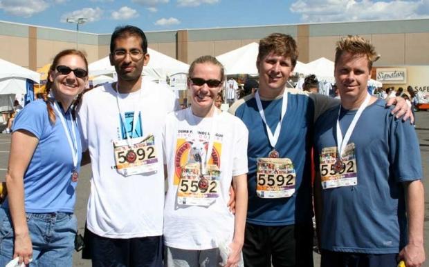 Team posing at marathon