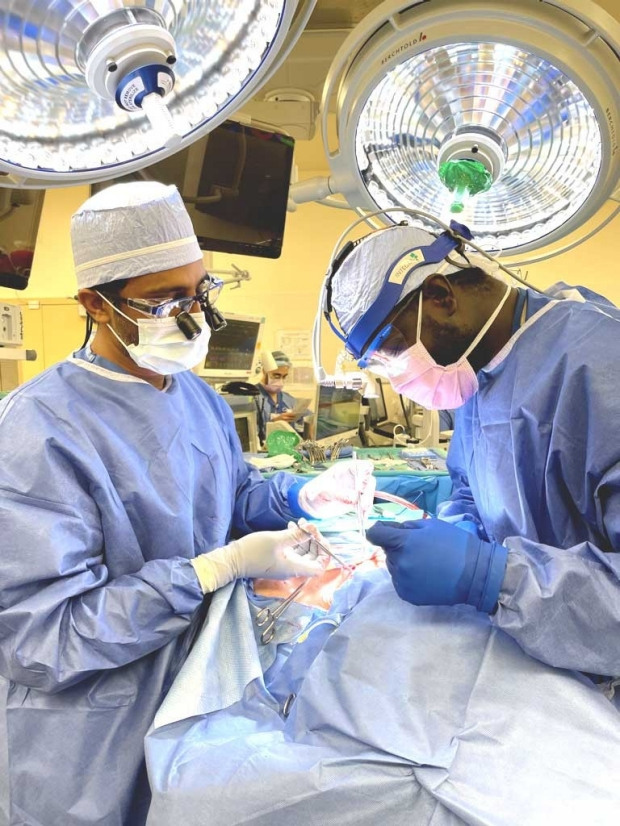 Surgeons Divi and Diop in the operating room