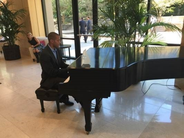 Brandon Baird, MD playing the piano at the Stanford Alumni Center